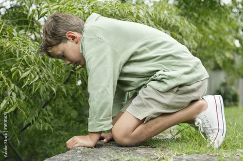 Boy playing in a garden