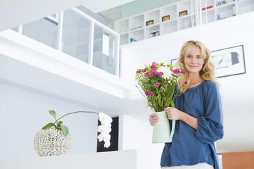 Woman holding a flower pot