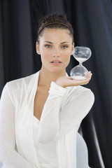 Woman holding an hourglass