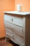 chest of drawers with candle glass poster