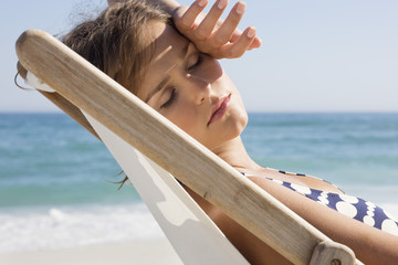 Close-up of a woman resting in a deck chair