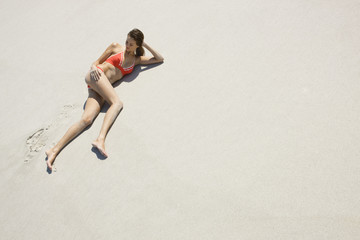 High angle view of a woman lying on the beach