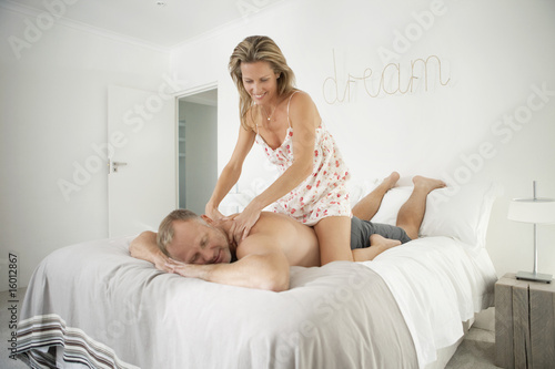 Woman massaging back of a man