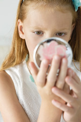 Girl holding a hand mirror