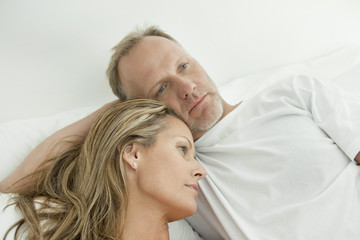 Couple resting on the bed