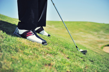 Golf shoes close up on course