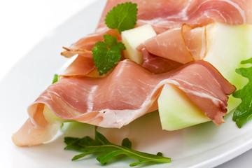 Prosciutto di Parma ham and three slice of melon