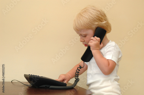 Child presses telephone buttons