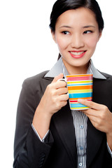 An attractive businesswoman with cup