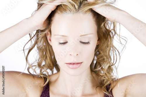 A portrait of a young blonde woman looking stressed