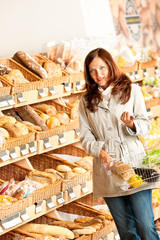 Grocery store: Young woman with shopping basket