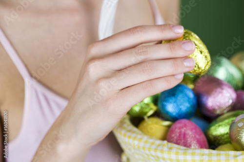 A woman holding an Easter egg, close-up