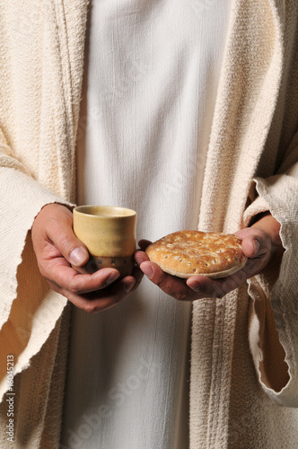 Jesus holding a bread and a wine