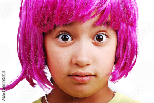 Adorable girl with pink hair and facial gesture