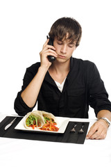 Young man on phone about to eat