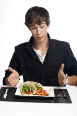 Young man about to eat delicious tacos