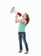 Young girl with megaphone on white background