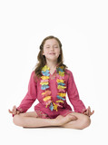 Pretty, young girl wearing kaftan in relaxed yoga pose