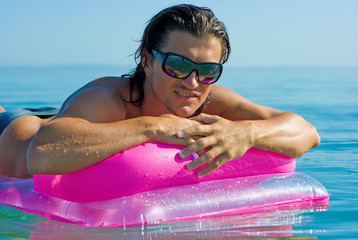 Handsome man on inflatable raft