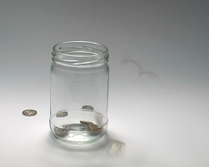 Coins Falling into Jar