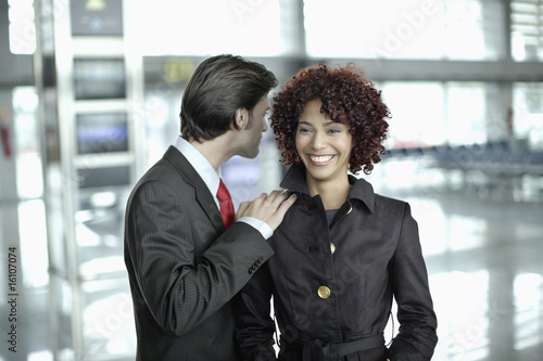 Couple standing in airport
