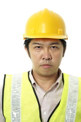 Asian construction contractor with blank expression