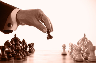 businessman playing chess game sepia tone