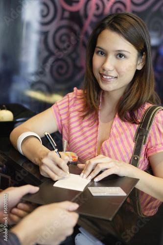 Woman at restaurant paying check