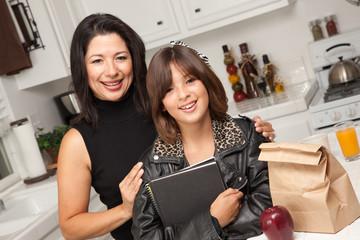 Attractive Hispanic Proud Mom with Her Pretty Schoolgirl Daughte