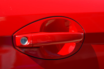 The modern red handle door of car
