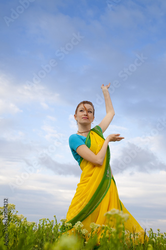 Beautiful Woman  / Indian Culture  / blue sky and green grass