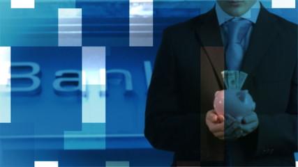 Businessman holding a piggy bank