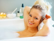 Cute woman relaxing in a bubble bath