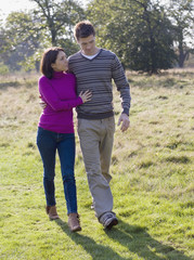 Couple outdoors walking arm in arm