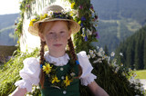 Austria, Salzburg land, Girl in traditional costume sitting in wagon