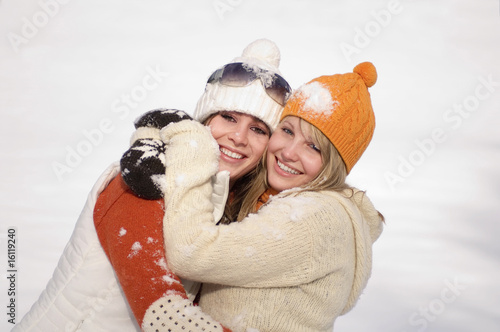 Two young woman embracing