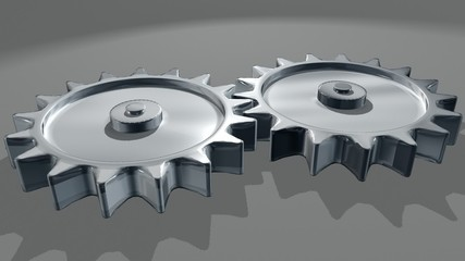 Interlocking gears turning showing teamwork concept