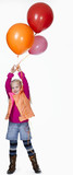 Girl (8-9) holding bunch of balloons, smiling, portrait