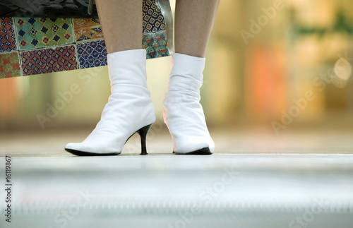 Woman wearing half-boots, low section