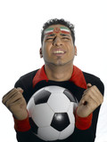 Man with Iranian flag painted on face holding soccer ball