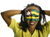 Woman with Togo flag painted on face, close-up, portrait