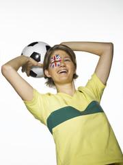Australischer weiblicher Fußballfan hält Fußball