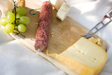 Sausage and cheese on chopping board