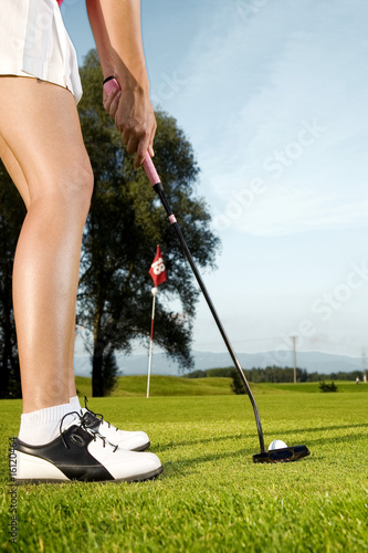 Woman playing golf, close-up