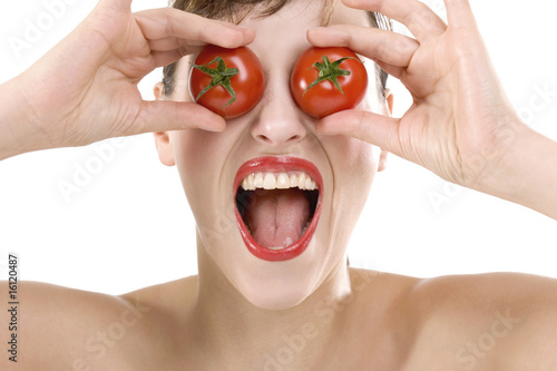 Woman, eyes covered with tomatoes, close-up