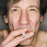 Man smoking, close-up, portrait
