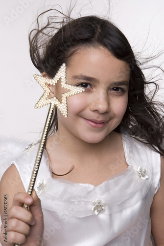 Girl dressed as angel, portrait