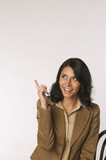Young woman, pointing with finger, portrait