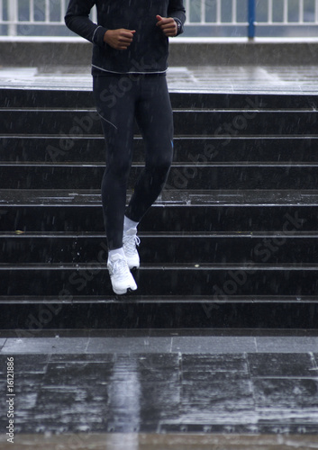 Man coming down steps in the rain