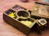 Compartmented wooden box with various herbs, close-up
